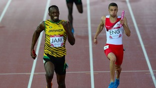 Usain Bolt wins the 4 x 100m relay ahead of England's Danny Talbot.