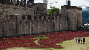Visitors walk among the Blood Swept Lands and Seas of Red installation at the Tower of London.