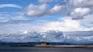 Cloud and sea, blue sky above
