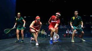 England's Alison Waters and Peter Barker (center) in action against Australia's David Palmer and Rachael Grinham.