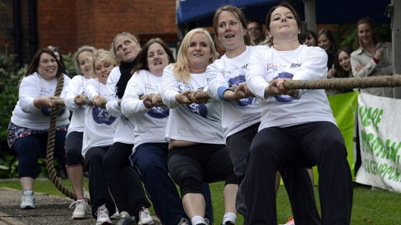 A team of female MPs also took part in a tug-of-war match