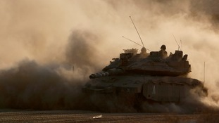 An Israeli tank drives near the border with Gaza.