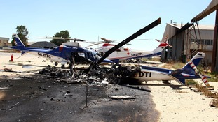 Damaged helicopter at Tripoli airport in July.