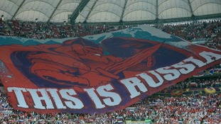 A giant banner in the stands reads 'This is Russia' during the match.