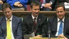 Culture Secretary Jeremy Hunt sits flanked by Prime Minister David Cameron and Deputy Prime Minister Nick Clegg.