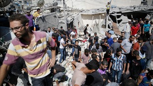 Palestinians dig through the rubble at the Shati refugee camp in Gaza City.