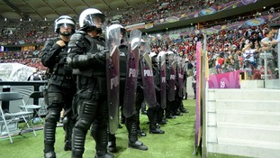 Riot police on the pitch after the final whistle at the National Stadium in Warsaw.
