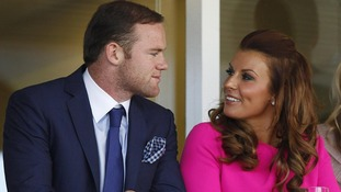 Here come the WAGs! Coleen Rooney jets off to Poland