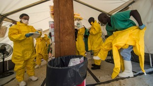 Medecins sans Frontieres staff in Sierra Leone don protective clothing in Sierra Leone