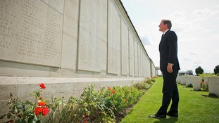 David Cameron looks at the names of the fallen First World War soldiers at the Loos Memorial.