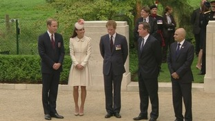 The Duke and Duchess of Cambridge stand with Prince Harry and David Cameron at St Symphorien military cemetery.