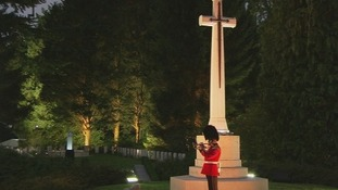 A lone guard plays the Last Post at the ceremony.