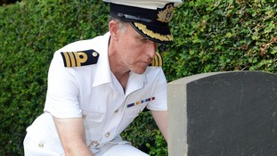 HMS Iron Duke Commanding Officer, Commander Tom Tredray lays his wreath at a War Cemetry near to Sekondi, Ghana.