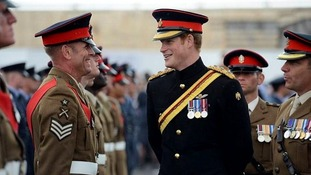 Prince Harry chats with some of the soldiers who marched down to the Harbour during the Short Step event in Folkestone, Kent.