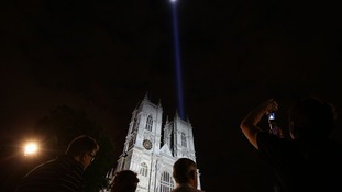 A column of white light created by Japanese artist Ryoji Ikeda is projected into the night sky.