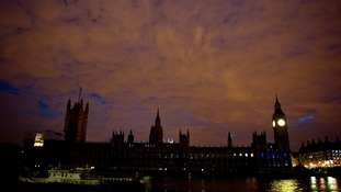 The Houses of Parliament look dramatic against the crimson sky as its lights go out.