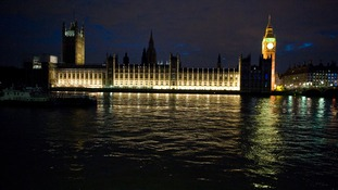 The familiar view of the Houses of Parliament fully lit up.