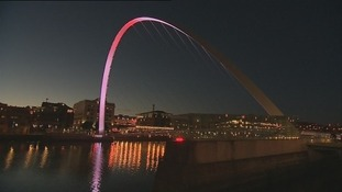 The Millennium Bridge in Gateshead lit up in pink.