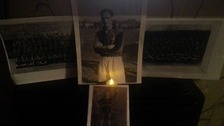 This Facebook user lit a single candle in front of photographs of his relative who may have died during WWI.