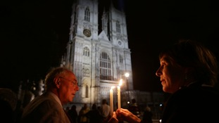 Paul and Alison Schulte holding candles outside Westminster Abbey, in London, during a candle lit prayer vigil and solemn reflection to mark centenary of First World War.