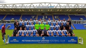 Ashley Cole sneaked into Peterborough United's team photo yesterday.