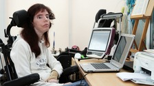 Dawn Faizey-Webster, who has locked in syndrome, at her work station at home.