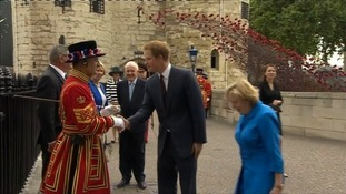 Prince Harry shakes hands with one of the Tower's famous Beefeaters.