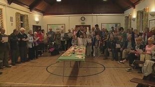 People gathered in the town hall to sing war-time songs together