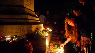 A vigil takes place at the foot of the war memorial in Sheringham, Norfolk, last night.
