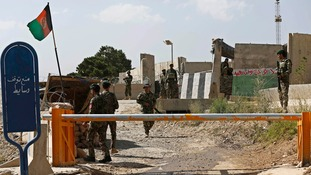 Afghan National Army (ANA) soldiers keep watch at the gate of military training academy Camp Qargha, in Kabul.