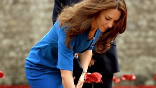 Ceramic poppies made in Plymouth are planted by the Duke and Duchess of Cambridge