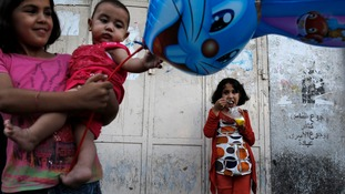 Palestinian children Palestinians enjoy an afternoon out during the first day of a three day ceasefire in Gaza city.