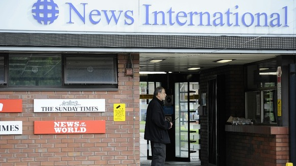A security guard stands at the entrance to News International offices in Wapping last summer