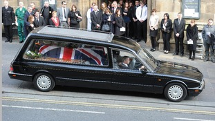 Darren Rathbanddrives the hearse carrying his brother's coffin from St Nicholas Cathedral, Newcastle