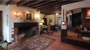The six-bedroom property includes a dining room to seat 16 people, with wood panelling and a grand fireplace.