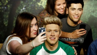 Makeover complete, Becky Griffiths poses with One Direction's Niall Horan's waxwork.