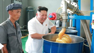 North Korean leader Kim Jong Un smiles during a visit to the Chonji Lubricant Factory.