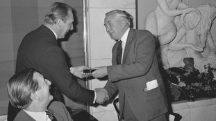 Prime Minister Harold Wilson presented Harry Chapman Pincher with an award as the Reporter of the Decade in the 1960s.