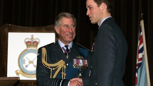 Prince William receives his flying wings from his father Prince of Wales.