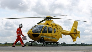 Critical Care Manager Gary Spitzer makes his way towards the East Anglian Air Ambulance at Cambridge Airport.