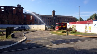 Fire crews 'damping down'