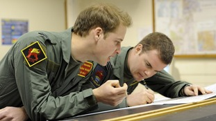 Prince William during pre-flight planning at RAF Linton-On-Ouse.