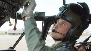 Prince William at the controls of his Sea King helicopter.