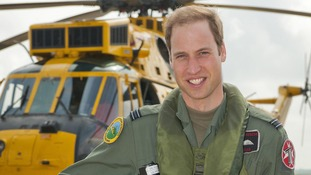 The Duke of Cambridge seen in front of Sea King helicopter.