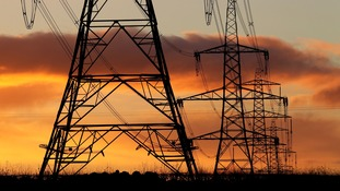 File photo dated 24/11/10 of electricity pylons.
