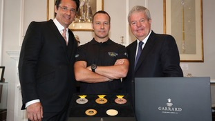 Chief executive Eric Deardorff, the games' chairman Sir Keith Mills, and injured soldier Craig Gadd, who is hoping to compete, revealed the medals.