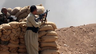 Kurdish Peshmerga troops in battle with Islamic State forces in northern Iraq