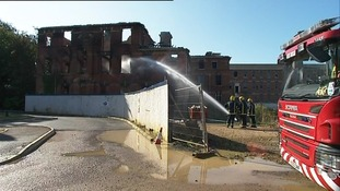 Firefighters 'damping down'