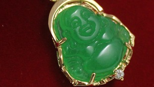 A buddha pendent that is similar to a larger version that was stolen during a burglary.
