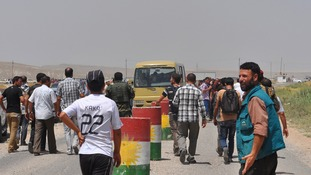 Tens of thousands fled the weekend assault on Kurdish forces at Sinjar and are now surrounded by Islamist militants.